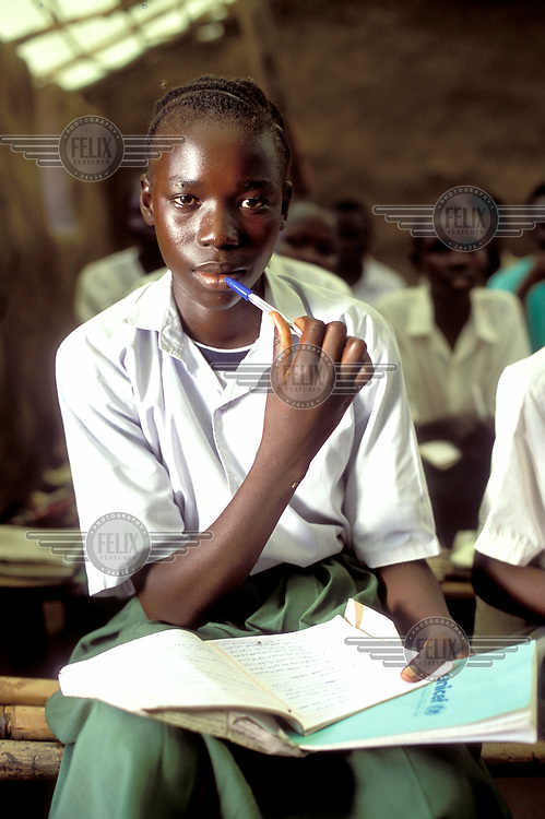 © Giacomo Pirozzi / Panos Pictures..Juba, SUDAN\..Girl with a Unicef jotter in a school for internally displaced children.