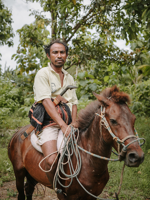 A local of Karuni, an area famous for horsebreeding, Southwestern Sumba.
