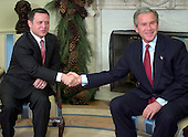 United States President George W. Bush meets King Abdullah II of the Hashemite Kingdom of Jordan in the Oval Office of the White House in Washington, D.C. on December 6, 2004..Credit: Ron Sachs / CNP.