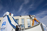 In this photo provided by the Reno Sparks Convention and Visitor's Authority, Squaw Valley skier J. T Holmes gets the ramp ready to perform an urban Ski-BASE jump off the roof of the Silver Legacy hotel casino in downtown Reno, Nev., Saturday Nov. 17, 2007. The stunt was to promote the local premier of the 2007 Warren Miller ski movie Playground and to raise money for the Make-a-Wish foundation, which helps make wishes come true for seriously ill children.