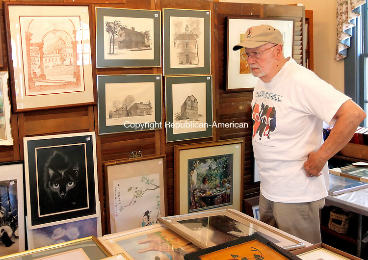 Woodbury, CT-16 June 2012-061612CM15- COUNTRY LIFE ONLY PLEASE ---- Bob Hirsch of Bethlehem, checks out the art gallery during the St. Paul's Episcopal Church Fair, Saturday morning in Woodbury. The fair welcomed patrons with a silent auction and treasure chest, food, games, baked goods, an art gallery and more.  Proceeds from the fair will benefit the church and their outreach program, which provides money for scholarships and supports the local community.   Christopher Massa Republican-American