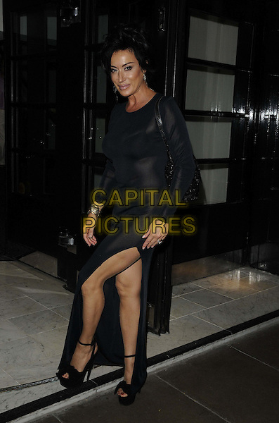 Nancy Dell'Olio.The 'Freddie For A Day' comedy/music fundraising evening for the Mercury Phoenix Trust, Savoy Hotel, The Strand, London, England..September 3rd 2012.full length black leather dress platform shoes dangling earrings ankle strap slit split see through thru bra .CAP/CAN.©Can Nguyen/Capital Pictures.