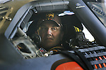 Dale Jarrett sits in the cockpit of the No. 88 UPS Ford as his crew makes adjustments to the car during NASCAR Nextel Cup testing at Daytona International Speedway in Daytona Beach, Fla., Wednesday, January 18, 2006.  Jarrett posted the fastest time for the morning test session with a speed of 189.215 miles per hour.(AP Photo/Brian Myrick)