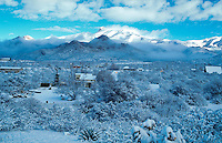 Overview of the historic ghost town of Dos Cabezas as a winter snow storm provides a rare White Christmas - 12-25-97. Arizona.