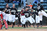 April 10, 2010:  Miles Durham (28), Jordy Mercer (14), Hector Gimenez (23), Matt Hague (back), Chase d'Arnaud (far back) of the Altoona Curve celebrate as Josh Harrison scores the winning run in the 10th inning during a game at Blair County Ballpark in Altoona, PA.  Photo By Mike Janes/Four Seam Images