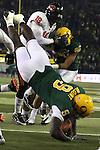 Oregon's LeGarrette Blount tumbles into the end zone for a touchdown  in the second half of the Civil War at Autzen Stadium..Photo by Jaime Valdez