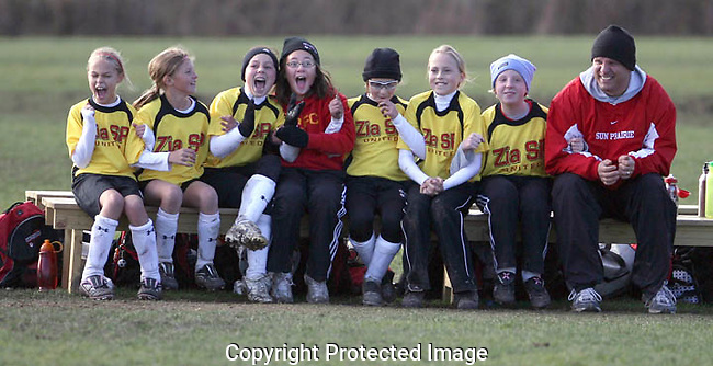 U-11 girls soccer players from the Sun Prairie ZIA United Power Club react from the bench as their team wins in a shoot-out with another Sun Prairie team to take first place in their Drumlin Flight at the Reddan Soccer Park's Ice Age Classic tournament.