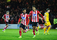 Lincoln City's Liam Bridcutt, left,celebrates scoring his side's equalising goal to make the score 1-1, with team-mate Tyreece John-Jules<br /> <br /> Photographer Andrew Vaughan/CameraSport<br /> <br /> The EFL Sky Bet League One - Lincoln City v Milton Keynes Dons - Tuesday 11th February 2020 - LNER Stadium - Lincoln<br /> <br /> World Copyright © 2020 CameraSport. All rights reserved. 43 Linden Ave. Countesthorpe. Leicester. England. LE8 5PG - Tel: +44 (0) 116 277 4147 - admin@camerasport.com - www.camerasport.com