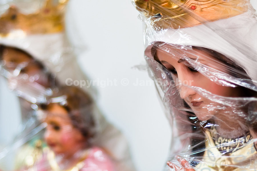 Madonna statue, foil-wrapped and ready for sale, seen in a Catholic religious shop in Bogota, Colombia, May 27, 2010. About 80% of the population in Colombia identify themselves as followers of the Catholic religion. Colombians are among the most devout of Latin American Catholics. Colombian Catholic church is renowned as one of the most conservative and traditional in Latin America, having traditionally been associated with elite structures in the society.
