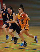 Action from the 2017 A Girls' Secondary Schools Basketball Premiership National Championship match between Opunake High School (gold) and Aquinas College (navy) at the B&M Centre in Palmerston North, New Zealand on Monday, 2 October 2017. Photo: Dave Lintott / lintottphoto.co.nz