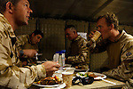 Mcc0018106 . SundayTelegraph..For the Sunday Telegraph..Soldiers from 2 Lancs at Fob Shawqat eating dinner n the Nad e'Ali district of Helmand province, southern Afghanistan...Afghanistan 9 November 09