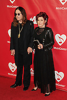 WWW.BLUESTAR-IMAGES.COM Singer Ozzy Osbourne and wife/TV personality Sharon Osbourne attend 2014 MusiCares Person Of The Year Honoring Carole King at Los Angeles Convention Center on January 24, 2014 in Los Angeles, California.<br /> Photo: BlueStar Images/OIC jbm1005  +44 (0)208 445 8588