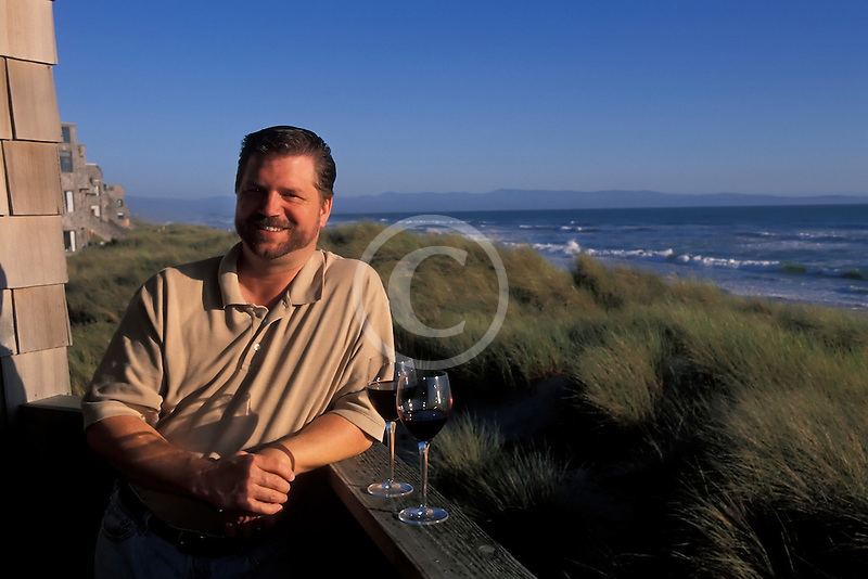 California, Santa Cruz County, Pajaro Dunes, Man relaxing on balcony