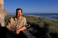 California, Santa Cruz County, Pajaro Dunes, Man relaxing on balcony