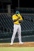 AZL Athletics relief pitcher Rafael Kelly (48) pumps his fists after recording the last out of a game against the AZL Cubs on August 9, 2017 at Sloan Park in Mesa, Arizona. AZL Athletics defeated the AZL Cubs 7-2. (Zachary Lucy/Four Seam Images)