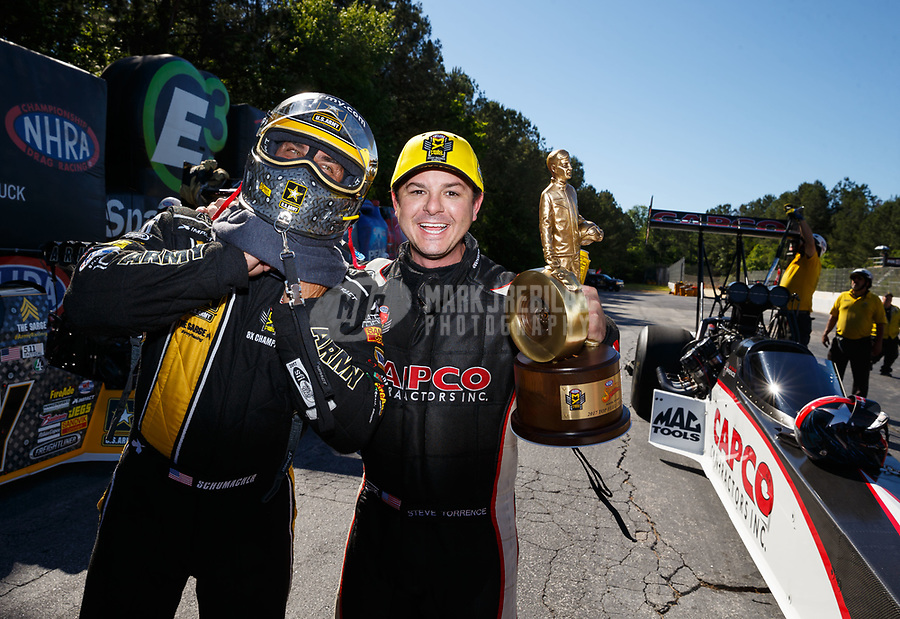 May 7, 2017; Commerce, GA, USA; NHRA top fuel driver Steve Torrence (right) celebrates with runner up Tony Schumacher after winning the Southern Nationals at Atlanta Dragway. Mandatory Credit: Mark J. Rebilas-USA TODAY Sports