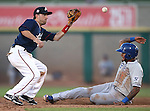 Reno Aces' second baseman Tyler Bortnick tags out Las Vegas 51s' Jordany Valdespin during a Triple-A baseball game in Reno, Nev., on Sunday, July 21, 2013. The 51s won 15-8.<br /> Photo by Cathleen Allison