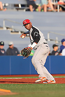 Miguel Gomez (2) of the Salem-Keizer Volcanoes makes a throw from third base during a game against the Hillsboro Hops at Ron Tonkin Field on July 27, 2015 in Hillsboro, Oregon. Hillsboro defeated Salem-Keizer, 9-2. (Larry Goren/Four Seam Images)
