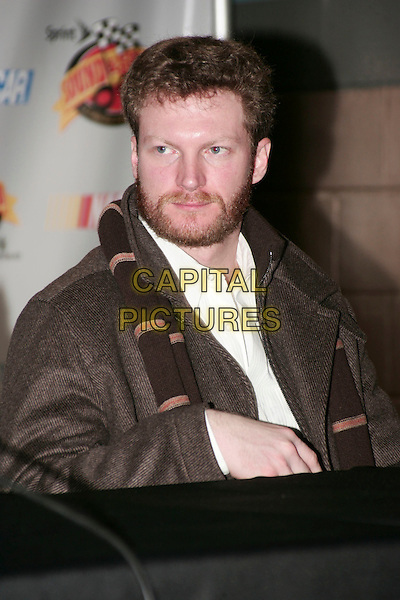 DALE EARNHARDT JR. .Fifth Annual Celebration of Music and Motorsports Sprint Speed and Sound Press Conference, Nashville, Tennessee, USA, 8th January 2010..half length brown scarf jacket beard facial hair sitting .CAP/ADM/EM.© Eddie Malone/AdMedia/Capital Pictures.