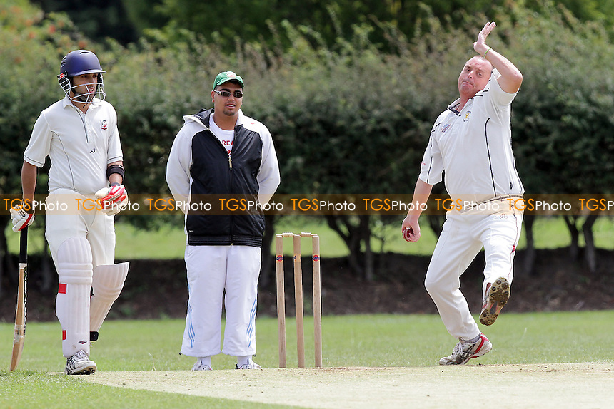 Oakley in bowling action for Ardleigh Green - Ilford CC 3rd XI (batting) vs Ardleigh Green CC 3rd XI - Essex Cricket League - 09/07/11 - MANDATORY CREDIT: Gavin Ellis/TGSPHOTO - Self billing applies where appropriate - Tel: 0845 094 6026 - contact@tgsphoto.co.uk