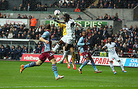 Sunday, 26 April 2014<br /> Pictured: Wilfried Bony challenged by Brad Guzan goalkeeper for Aston Villa.<br /> Re: Barclay's Premier League, Swansea City FC v Aston Villa at the Liberty Stadium, south Wales.