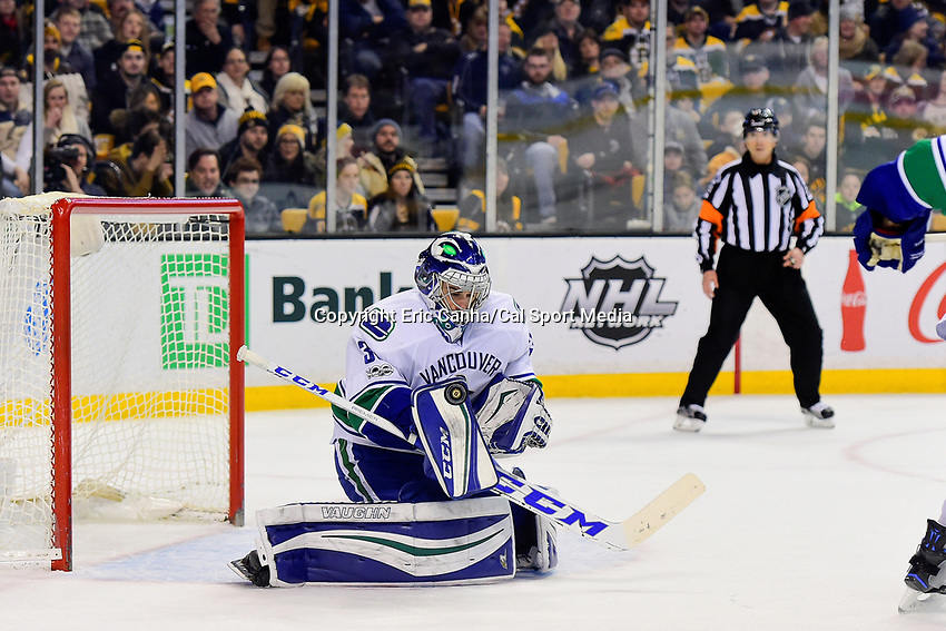 February 11, 2017: Vancouver Canucks goalie Ryan Miller (30) makes a save during the National Hockey League game between the Vancouver Canucks and the Boston Bruins held at TD Garden, in Boston, Mass. Boston defeats Vancouver 4-3 in regulation time. Eric Canha/CSM