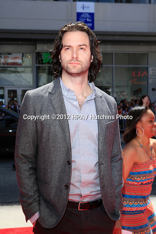 "LOS ANGELES - APR 10:  Chris D'Elia arrives at ""The Three Stooges"" Premiere at Graumans Chinese Theater on April 10, 2012 in Los Angeles, CA"
