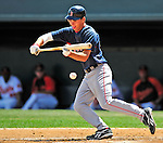 14 March 2009: Boston Red Sox' center fielder Josh Reddick lays down a bunt during a Spring Training game against the Baltimore Orioles at Fort Lauderdale Stadium in Fort Lauderdale, Florida. The Orioles defeated the Red Sox 9-8 in the Grapefruit League matchup. Mandatory Photo Credit: Ed Wolfstein Photo