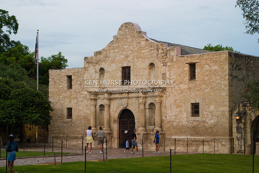 Tourists enjoying visiting the Alamo mission in San Antonio, Texas, historic landmark of the Texas Revolution.