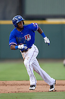 Round Rock Express outfielder Julio Borbon #20 runs during the Pacific Coast League baseball game against the Fresno Grizzlies on May 19, 2012 at The Dell Diamond in Round Rock, Texas. The Grizzlies defeated the Express 10-4. (Andrew Woolley/Four Seam Images)