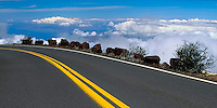 The ROAD high above the clouds leads to the crater in HALEAKALA NATIONAL PARK on Maui in Hawaii USA