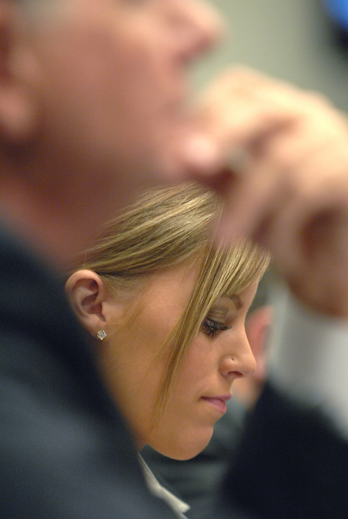 Jamie Leigh Jones, who was allegedly drugged and raped by her co-workers in Iraq, waits to testify with her Congressman, Rep. Ted Poe, R-Texas, foreground, before a House Subcommittee on Crime, Terrorism, and Homeland Security hearing.  Jones was an employee of Kellogg Brown and Root (KBR) in Baghdad, when the incident occurred in July 2005, when she was 20.