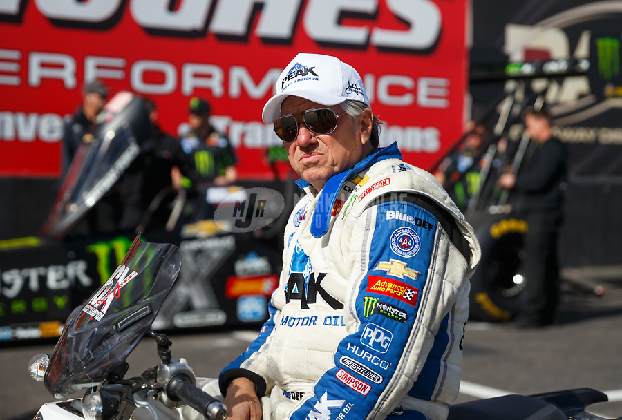 Feb 23, 2018; Chandler, AZ, USA; NHRA funny car driver John Force waits for daughter, top fuel driver Brittany Force to run during qualifying for the Arizona Nationals at Wild Horse Pass Motorsports Park. Mandatory Credit: Mark J. Rebilas-USA TODAY Sports
