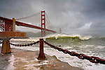 Large storm waves in San Francisco Bay under the Golden Gate Bridge about to batter the shore, California, USA.