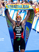 05 JUN 2010 - MADRID, ESP - Nicola Spirig  celebrates victory at the Madrid round of the womens ITU World Championship Series triathlon (PHOTO (C) NIGEL FARROW)