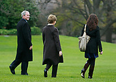 United States President George W. Bush (L) walks with his wife First Lady Laura Bush and daughter Barbara Bush (R) as they prepare to depart the White House on Marine One November 26, 2008 in Washington, DC. President Bush and his family are headed to Camp David for the Thanksgiving holiday. <br /> Credit: Mark Wilson / Pool via CNP