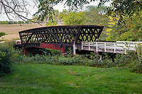 Cedar Bridge refers to two different bridges. The original Cedar Covered Bridge was built in 1883,moved in 1921, and was named to the National Register of Historic Places in 1976. The bridge was filmed in the 1995 movie The Bridges of Madison County, and destroyed by arson in 2002. <br /> <br /> The current covered Cedar Bridge was built in 2004. A replacement bridge was built to the same plans and specifications as the original and using authentic materials and techniques. It reopened during October, 2004. On April 15, 2017, the new bridge was again destroyed by fire.