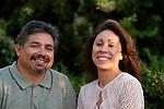 Hispanic couple smiling.