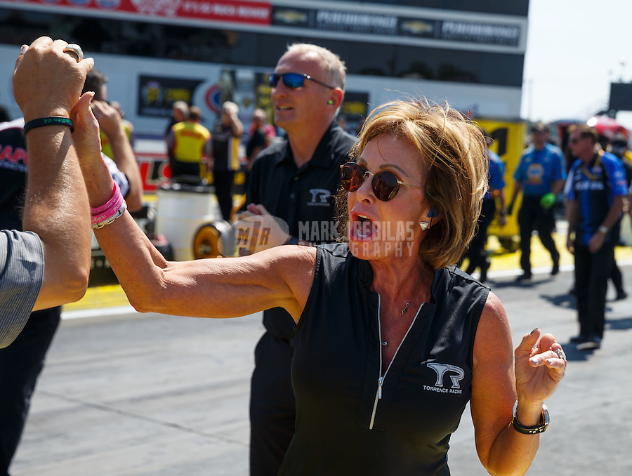 Sep 5, 2016; Clermont, IN, USA; Kay Torrence , mother of NHRA top fuel driver Steve Torrence celebrates during the US Nationals at Lucas Oil Raceway. Mandatory Credit: Mark J. Rebilas-USA TODAY Sports