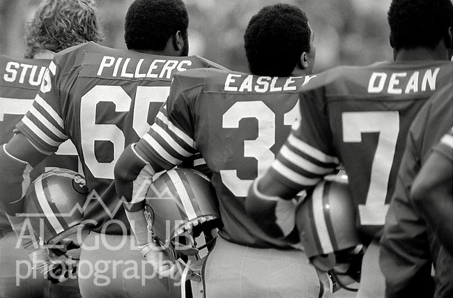 San Francisco 49ers vs. Houston Oilers at Candlestick Park Sunday, December 13. 1981.  49ers beat Oilers 28-6..On sideline at start of game San Francisco Players Jim Stuckey, Lawrence Pillers, Walt Easley, and Fred Dean...Photo By Al Golub/Golub Photography.
