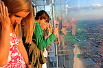 "Visitors look down from the newly opened glass balconies ""The Ledge"" at the Skydeck at the Sears Tower in Chicago, Illinois on July 6, 2009."
