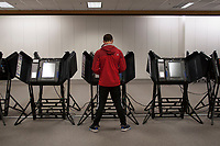 Voters use electronic voting machines at a Columbus, Ohio, early voting center on the first day of early voting in the state.