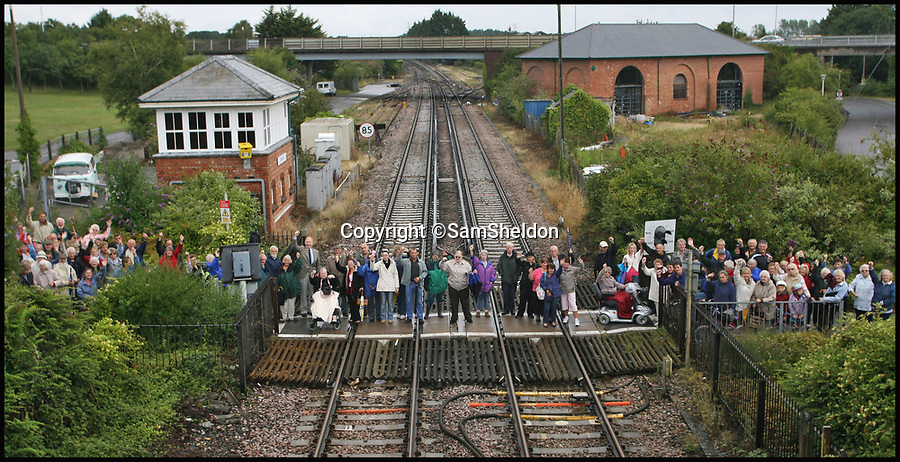 BNPS.co.uk (01202 558833)<br /> Pic: SamSheldon/BNPS<br /> <br /> Villagers protesting at the closure of the level crossing.<br /> <br /> The say of the jackal...<br /> <br /> The Day of the Jackal star Edward Fox has taken aim at bureaucrats over their plans to build a 'hideous' new railway bridge at his local Grade II listed Victorian station.<br /> <br /> The veteran actor, who also starred in the war film A Bridge Too Far, accused the local council of ignoring the wishes of the public by ploughing ahead with the unsightly ramped crossing.<br /> <br /> Mr Fox, 80, described the plans as 'a bridge too far' and urged planners to listen to the townsfolk of Wareham, Dorset, and go back to the drawing board.<br /> <br /> Thousands of local residents, led by Mr Fox, had already voiced their objections to a huge wheelchair-friendly bridge that will replace the current level crossing which officials say has become a health and safety hazard