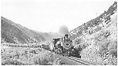 Front view of K-37 #495 eastbound at lower road crossing in Poncha Canyon 8:57 am.  Texaco 2-dome tank behind engine.<br /> D&amp;RGW  Poncha Canyon, CO  Taken by Maxwell, John W. - 7/7/1940