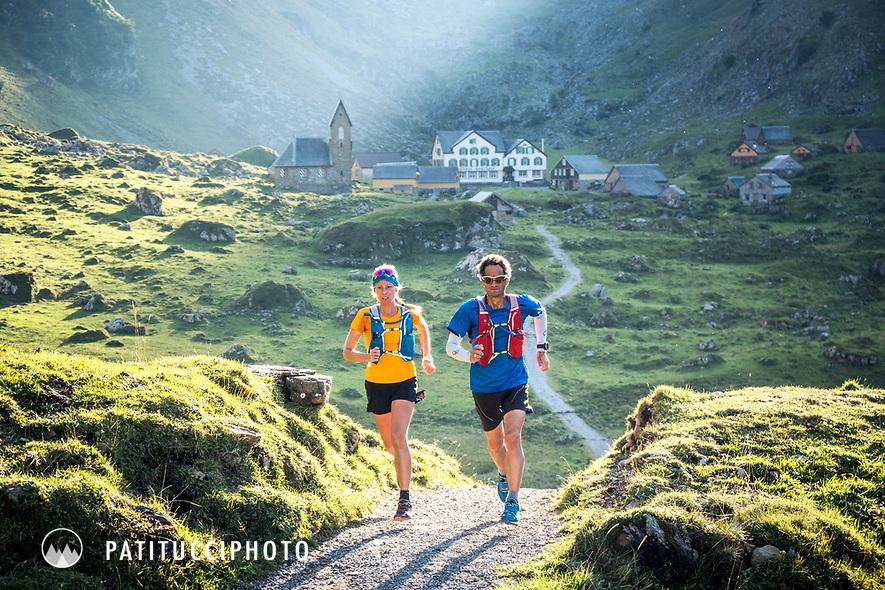 Trail running through the old dairy farm village of Meglisalp, in the Alpstein mountain region of eastern Switzerland.