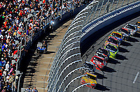 Nov. 1, 2009; Talladega, AL, USA; NASCAR Sprint Cup Series driver Kevin Harvick leads the field throuigh the tri-oval behind the newly installed catch fence during the Amp Energy 500 at the Talladega Superspeedway. Mandatory Credit: Mark J. Rebilas-