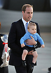 AUSTRALIA, Canberra : Britains Prince William walks with Prince George during the  arrival at Defence Establishment Fairbairn, Canberra on April 20, 2014. Britain's Prince William, his wife Kate and their son Prince George are on a three-week tour of New Zealand and Australia. AFP PHOTO / Mark GRAHAM
