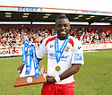 Yemi Odubade of Stevenage Borough celebrates with the Blue Square Premier championship trophy after the Blue Square Premier match between Stevenage Borough and York City at the Lamex Stadium, Broadhall Way, Stevenage on Saturday 24th April, 2010..© Kevin Coleman 2010 ..