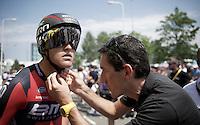 BMC TT coach Marco Pinotti adjusting Greg Van Avermaet's (BEL/BMC) new helmet just before mounting the start podium<br /> <br /> stage 1 prologue: Utrecht (13.8km)<br /> Tour de France 2015