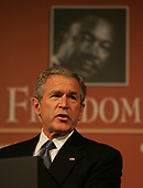 """Washington, D.C. - January 16, 2006 -- United States President George W. Bush  speaks at  the presentation of the annual John Thompson Jr. """"Legacy of a Dream Award"""" at the Kennedy Center in Washington, DC on January 16, 2006.<br /> Credit: Dennis Brack - Pool via CNP"""